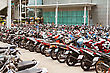 Italy PHUKET, THAILAND - NOVEMBER 20: Many Motorbikikes At The Parking Near Big Store On November, 20, 2010, Phuket, Thailand. Motorbike Is A Most Popular Transport In Thailand stock photo