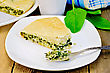 Pie With Spinach And Cheese On A Plate, Spinach Leaves, Mug, Fork, Napkin On Wooden Board