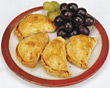 Pies, Empanadas & Grapes On Plate stock photography