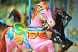 Fun Pink And Black Horses On The Carousel In City Park stock photo