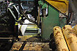 Pinus Radiata Logs Go Through The First Bandsaw In A Sawmill