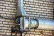 Casing Pipes And The Fan On A Brick Wall stock image
