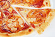 Pizza Closeup With Salami, Tomato, Onion And Mozzarella Cheese stock image