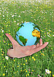 Planet Earth In An Open Hand On A Field Of Flowers stock illustration