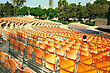 Plastic Yellow Chairs In Summer Amphitheatre stock image