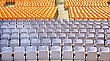 Theater Plastic Yellow And Pink Chairs In Summer Amphitheatre. stock image