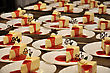 Plates Of Cheesecake Ready To Serve At A Reception