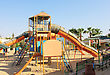 Playground For Kids At Sun Light. Game Playground Outdoor