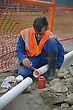Plumber Joins New Pipes For A Stormwater Drain stock photo