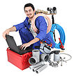 Plumber Preparing His Equipment And His Laptop stock image
