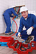 Plumbers At Work stock photography