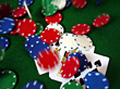 Poker Chips Falling Onto Cards - Blur stock photography