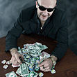 Winner Poker Player Hording Cash stock photography