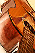 Polished Surface Of The Body Acoustic Guitar With A Neck And Strings stock photo