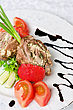 Grilled Pork Rolls With Cheese And Vegetables: Onion, Cucumbers, Tomatoes stock photography
