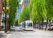 PORTLAND - MAY 4: Light Train Of The Portland Streetcar System On May 4, 2014 In Portland, Oregon. The Portland Streetcar System Opened In 2001 And Serves Areas Surrounding Downtown Portland stock photography