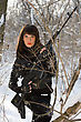Portrait Of Attractive Young Woman With A Sniper Rifle In Winter Forest stock photo