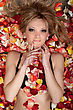 Portrait Of Beautiful Blonde Lying In Rose Petals