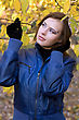 Portrait Of A Beautiful Girl Amongst The Autumn Leaves stock photo