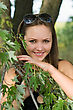 Portrait Of Beautiful Smiling Woman Behind The Tree Branch stock image