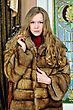 Wealth Portrait Of The Beautiful Woman In Fur Coat. The Luxurious Classical Interior. stock photo
