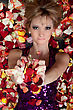 Portrait Of Charming Young Blonde Lying In Rose Petals stock image