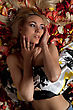 Seductive Portrait Of Charming Young Woman Lying In Rose Petals stock photo