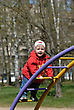 Playful Portrait Of A Child - A Little Girl Playing In The Park stock photo
