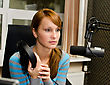 Portrait Of Female Dj Working In Front Of A Microphone On The Radio stock image