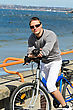 Portrait Of Handsome Male With Bicycle By The Sea