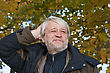 Portrait Of Mature Thoughtful Man With Grey Hair In Autumn Day stock photo