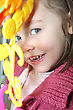 Portrait Of Mischievous Little Girl Posing With Toy stock photo