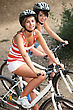 Portrait Of 2 Girls On Bikes stock photo