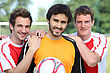 Portrait Of 3 Football Players stock photography