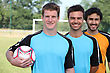 Practice Portrait Of 3 Football Players stock photography