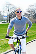 Portrait Of Handsome Male Riding A Bicycle
