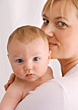 Portrait Of Mother Holding Baby stock photography