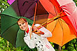 Portrait Of Pretty Woman With Umbrellas stock photography