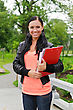 Portrait Of Smiling Female Student Outdoors