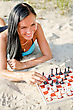 Hobbies Portrait Of Pretty Woman Playing Chess On The Beach stock photo