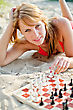 Portrait Of Pretty Woman Playing Chess On The Beach