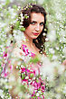 Portrait Of Pretty Young Brunette Posing In Flowering Trees stock photo