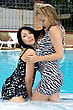 Portrait Of The Two Playful Girlfriends In Pool stock photography