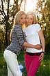 Portrait Of Two Pretty Young Blonde Outdoors