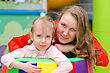 Portrait Of Woman And Little Girl In Playroom stock photography