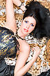 Portrait Of A Young Brunette In A Corset Posing On Fur stock photography