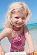 Portrait Of Young Girl In Pink Swimsuit stock photo