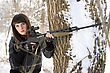Portrait Of Young Lady With A Sniper Rifle