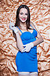 Portrait Of Young Sexy Brunette Posing In Blue Dress And White Gloves