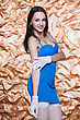 Studio Portrait Of Young Sexy Woman Posing In Blue Dress And White Gloves stock photography